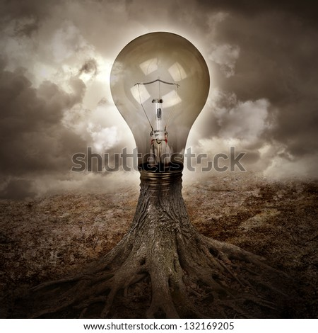 A light bulb is growing as a tree in a dark nature scene with roots for an energy or idea concept. - stock photo