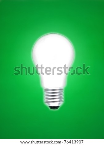 A light bulb isolated against a green background