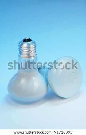 A light bulb isolated on blue background. - stock photo