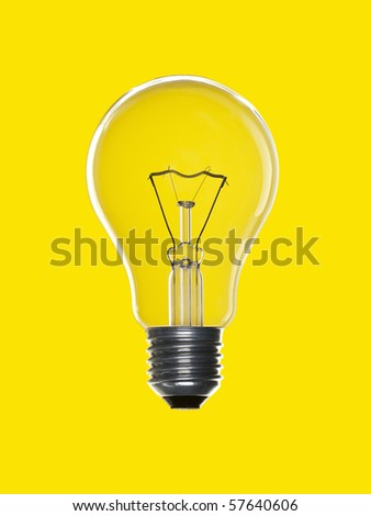 A light bulb over a yellow background. - stock photo