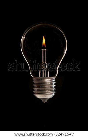 A light-bulb with candle flame inside - stock photo