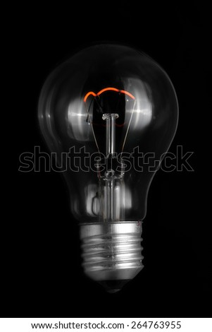 A light bulb without cable on black background