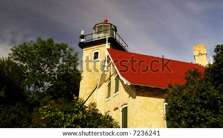 A light house located in Door County on Lake Michigan - stock photo