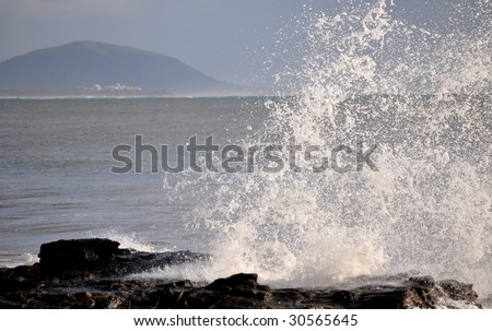 A light spray with mountain in background - stock photo