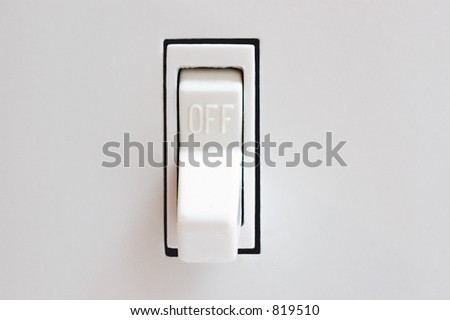 A light switch in the off position. - stock photo