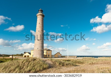 A lighthouse by the sea in Skagen in Denmark - stock photo