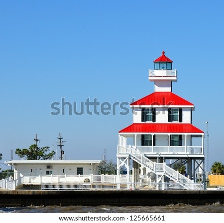 A Lighthouse On The Shore Of Lake Pontchartrain In New Orleans, Louisiana - stock photo