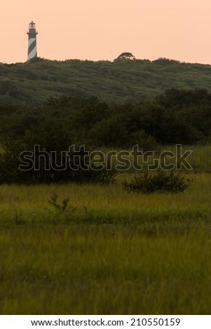 A lighthouse over a coastal marsh.  St. Augustine, FL, USA. - stock photo