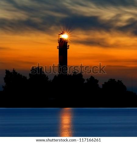 a lighthouse shining at late evening. Riga, Latvia - stock photo
