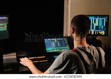 A lighting engineer works with lights technicians control on the concert show. Professional light mixer & Lighting Engineer Works Lights Technicians Control Stock Photo ...