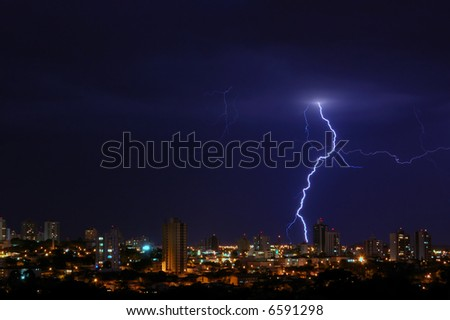 A lightning over a city at night.