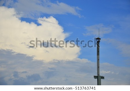 A lightning rod and smokestack