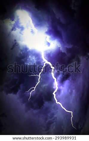 A lightning strike on the cloudy sky. - stock photo