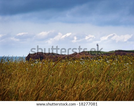 A lightouse in a field - stock photo