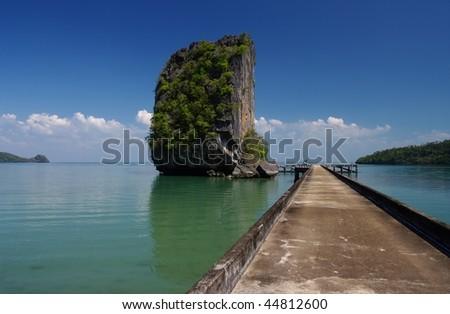 A limestone karst Island at Talo Wao Bay, Ko Tarutao. Tarutao National Marine Park.  Satun, Southern Thailand - stock photo