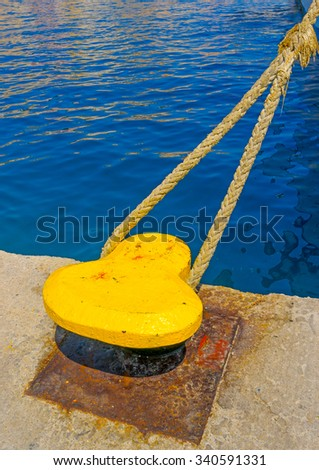 a line from a ferry boat docked in the main port of Symi island in Greece - stock photo