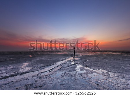 A line left when fisherman pulling their boat during low tide - stock photo