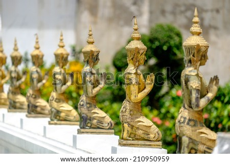 A line of beautiful Buddha statues in Thai temple - stock photo