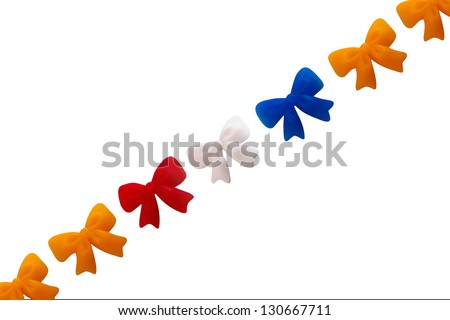 a line of color bows, symbol of the dutch coronation - stock photo