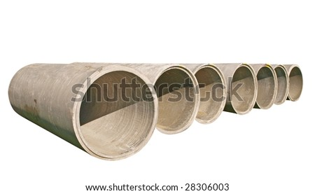 A Line of Concrete Pipes isolated with clipping path - stock photo