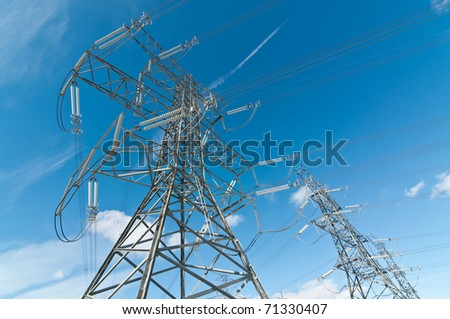A line of electrical transmission towers carrying high voltage lines.