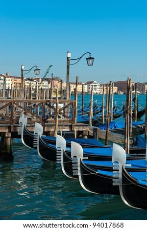 A line of gondolas in Venice - stock photo