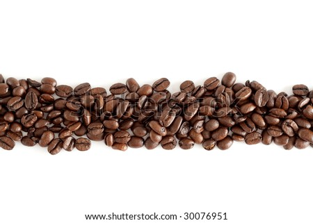 A line of isolated coffee beans with white background - stock photo
