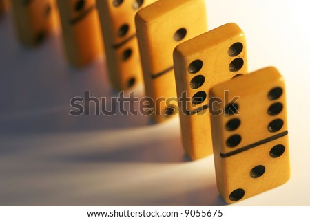 A line of old, vintage dominoes, ready to fall