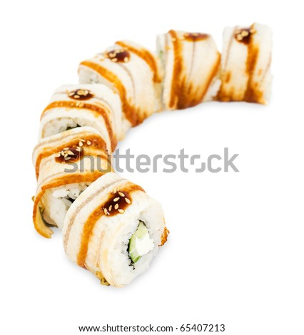 a line of sushi rolls wrapped in eel meat - stock photo