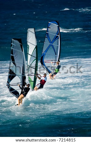 A line of three windsurfers off the coast of Maui - stock photo