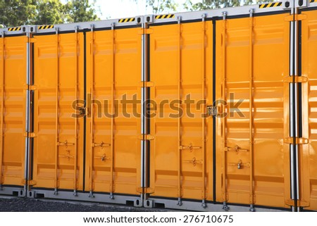 A line of yellow and grey metal storage containers - stock photo