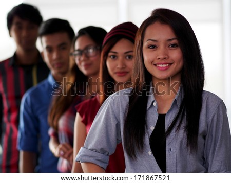 A line up of college students - stock photo