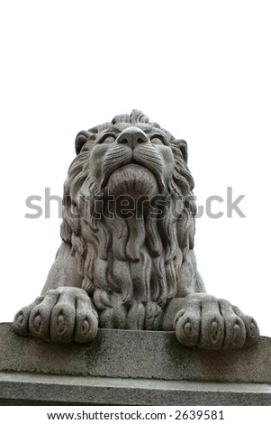A lion statue sits majesticaly on it's pedestal. Isolated against a sky. - stock photo