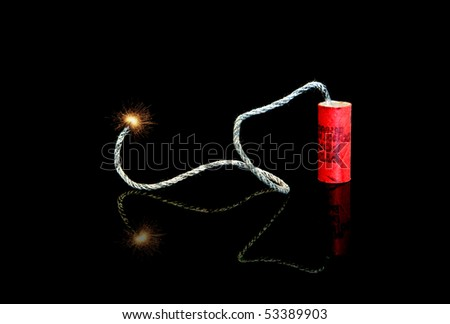 A lit fuse on an old M-80 firecracker - stock photo