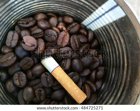 A littered Cigarette butt on roasted coffee beans ashtray in silver canned