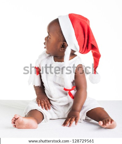 A little African girl, dressed as Ms. Christmas Astrix. - stock photo