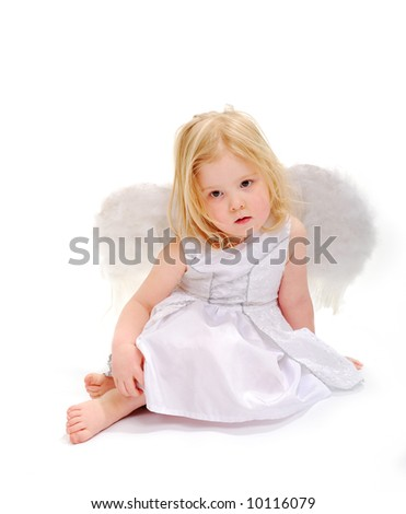 A little angel girl (age 3) has a rest on white.