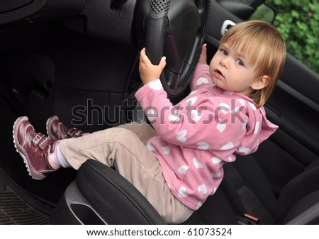 a little baby driving car - stock photo