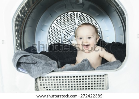A Little baby in the washing machine