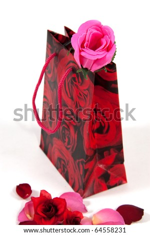 A little bag with a rose in it on white