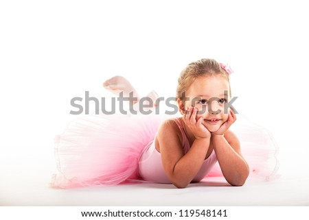 A little ballerina playing around in the studio. - stock photo
