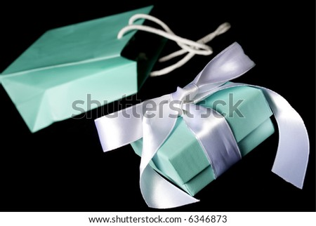A little blue bag with matching gift box. - stock photo