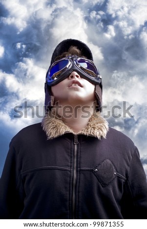 A little boy dreams of becoming a professional pilot. Vintage aviation hat. - stock photo