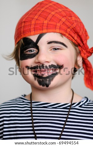 A little boy dressed as pirate