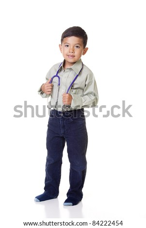 A little boy dresses up as a doctor in a concept image.. - stock photo