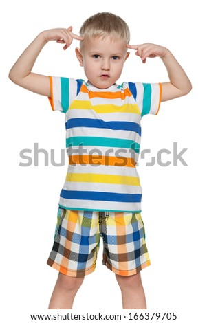 A little boy holding his point fingers at the head and thinking over something - stock photo