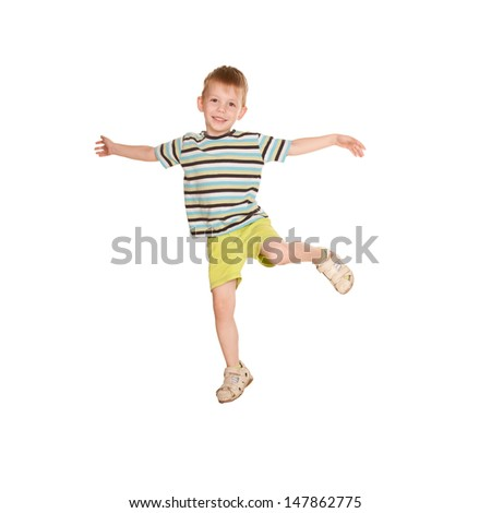 A little boy in a striped T-shirt dancing. Cheery party. Isolated on white background.