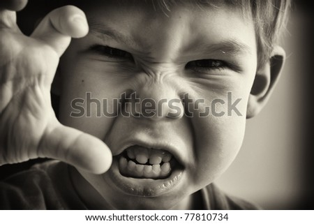 A little boy in anger - stock photo