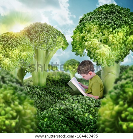 A little boy is reading a book in a surreal nature landscape. The broccoli vegetables are trees and grass for a health or education concept. - stock photo
