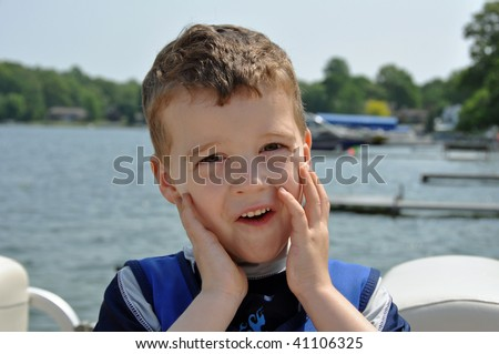 a little boy makes a shocked funny face - stock photo